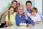stock photo of birthday party  - Family celebrating grandfather - JPG