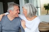 picture of old couple  - Happy senior couple looking at each other - JPG