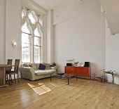 high ceiling apartment with large gothic windows