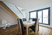 modern duplex apartment with hard wood furniture and staircase