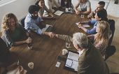 Diverse people teamwork on meeting table poster