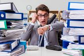 Busy businessman under stress due to excessive work poster