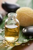 pic of massage oil  - essential oil and stones - JPG