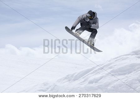 Snowboarder flying on the background