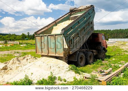 The Dump Truck Unloads Sand