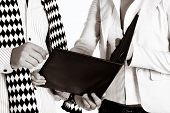 stock photo of semi-formal  - businesswoman and her partner with a black leather folder - JPG