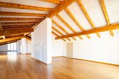 Large empty room with wooden beams and parquet. Nobody inside poster