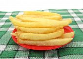 stock photo of pommes de terre frites  - French fries potato in red plate on green tablecloth - JPG