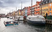 Tourist Boat Goes On Nyhavn Or New Harbour, It Is A 17th-century Waterfront, Canal And Popular Touri poster