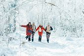 Beautiful Teenage Girls Having Fun Outside In A Wood With Snow In Winter. Friendship And Active Life poster