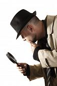 stock photo of crime solving  - Detective investigate with magnifying glass - JPG