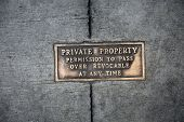 Metal Words in the Sidewalk. Old Metal Words imbedded in cement. Private Property Sign in brass. poster