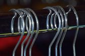 Clothes Hangers With Bokeh Background, Metal Clothes Hangers On Clothes Rail Macro Shot poster