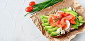 Sandwich With Avocado And Salmon, Green Onions And Gluten-free Grain Bread, Radishes And Tomatoes. C poster