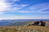 Beautiful View From The Mountain Plateau To The Horizon. Blue Sky And Mountain Ranges And Valleys On poster