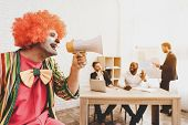 Man In Clown Costume With Loudspeaker In Office. April Fools Day. Businessman In Office. April Jokes poster