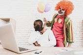 Young Man In Clown Costume With Baloons In Office. April Fools Day. Businessman In Office. April Jok poster