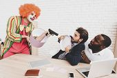 Young Man In Clown Costume On Meeting In Office. April Fools Day. Man With Gift Box. April Jokes. To poster