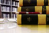 picture of law-books  - Law books stacked in a library with pen and glasses - JPG