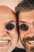 Old Father And Son. Fathers Day. Crazy Emotions Close Up. Comical Dad And Son. Funny Expression Peop poster