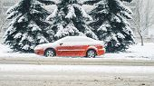 Red Car Covered With Snow Stands On The Side Of A Winter Snow-covered Road. Side View Of An Abandone poster