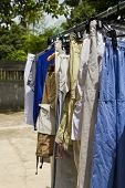 stock photo of wet pants  - Shirts and pants hanging on a clothes line - JPG