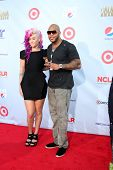 LOS ANGELES - SEP 16:  StayC Reign, Flo RIda arrives at the 2012 ALMA Awards at Pasadena Civic Audit