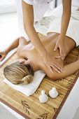 stock photo of massage therapy  - young female receiving professional massage in a wellness resort - JPG