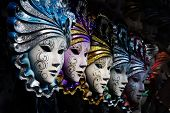 stock photo of mardi-gras  - Row of venetian masks in gold and blue - JPG