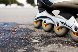 stock photo of inline skating  - closeup of the inline skates - JPG