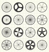 stock photo of bicycle gear  - Collection of retro bike wheel silhouettes in a grid - JPG