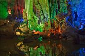 pic of underground water  - colorful limestone cave with perfect reflections in water - JPG