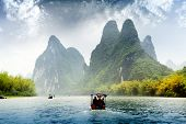 image of raft  - Beautiful Yu Long river Karst mountain landscape in Yangshuo Guilin China - JPG