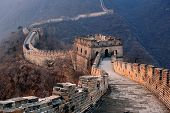 stock photo of wall-stone  - Great Wall sunset over mountains in Beijing - JPG