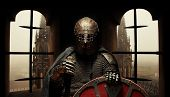 stock photo of armor suit  - Medieval knight in the armor with the sword and helmet - JPG