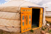 stock photo of yurt  - Yurt or ger exterior in the Mongolian countryside - JPG