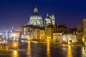stock photo of gondolier  - View of Basilica di Santa Maria della Salute at night under very dramatic sunsetVenice Italy - JPG