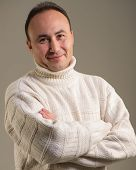 pic of debonair  - Portrait of a businessman in a sweater and smiling age thirty - JPG