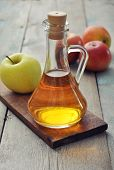 image of vinegar  - Apple cider vinegar in glass bottle and fresh apples - JPG
