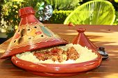 image of tagine  - tagine on the table in the garden a sunny day - JPG