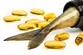 picture of tail  - Fish oil capsules and fish tail in brown jar - JPG
