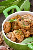 image of sauteed  - Sauteed mushrooms on the old wooden background - JPG