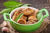 picture of sauteed  - Sauteed mushrooms on the old wooden background - JPG