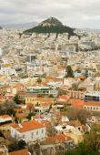 foto of akropolis  - View of the Mount Lycabettus and red roofs in the center of Athens Greece - JPG