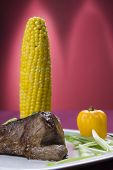 pic of phallus  - Grilled beef steak with cooked sweet corn - JPG