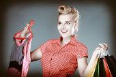 image of pinup girl  - Pinup blond girl young woman in retro style buying clothes pink dress - JPG
