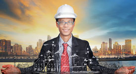 stock photo of land development  - young engineer and his urban development project use for construction industry and urban land development topic - JPG