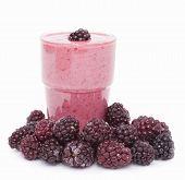 stock photo of frozen food  - Cocktail of frozen blackberries with yogurt . ** Note: Shallow depth of field - JPG