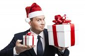 stock photo of boxing day  - man holding a gift box on a white background