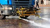 foto of water jet  - Special equipment mounted on the truck for street cleaning with water jets - JPG